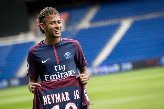 Neymar holding the jersey of PSG