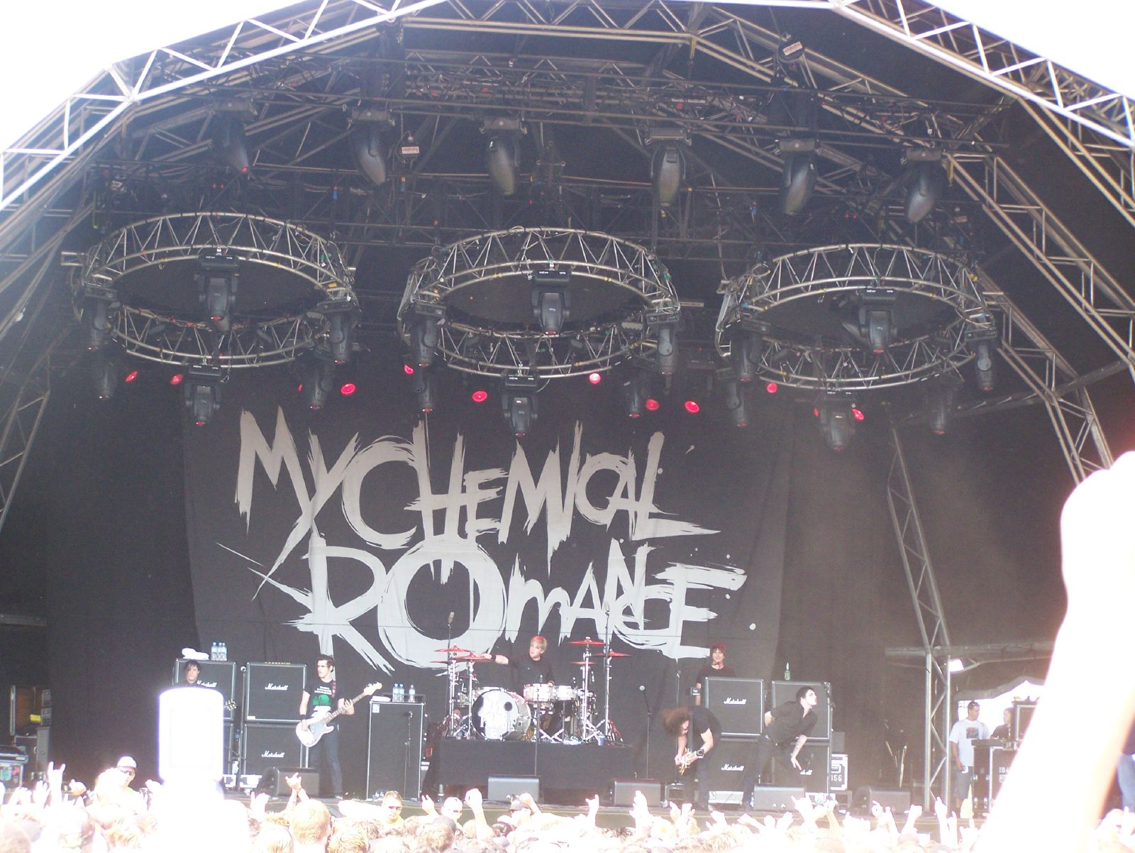 A MCR gig at a festival, huge banner saying MCR and the playing on stage.