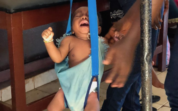 Baby at postnatal weigh in check, Freetown