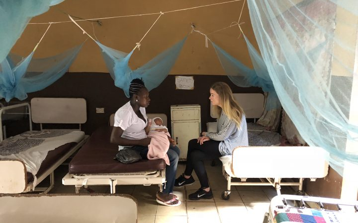 Eloise talks to new mother in George Brook health clinic, Freetown