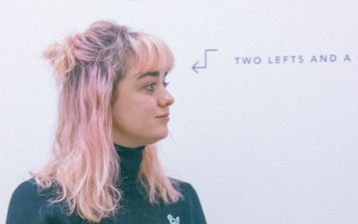 Maisie Williams showcasing her new pink hair at Daisie HQ