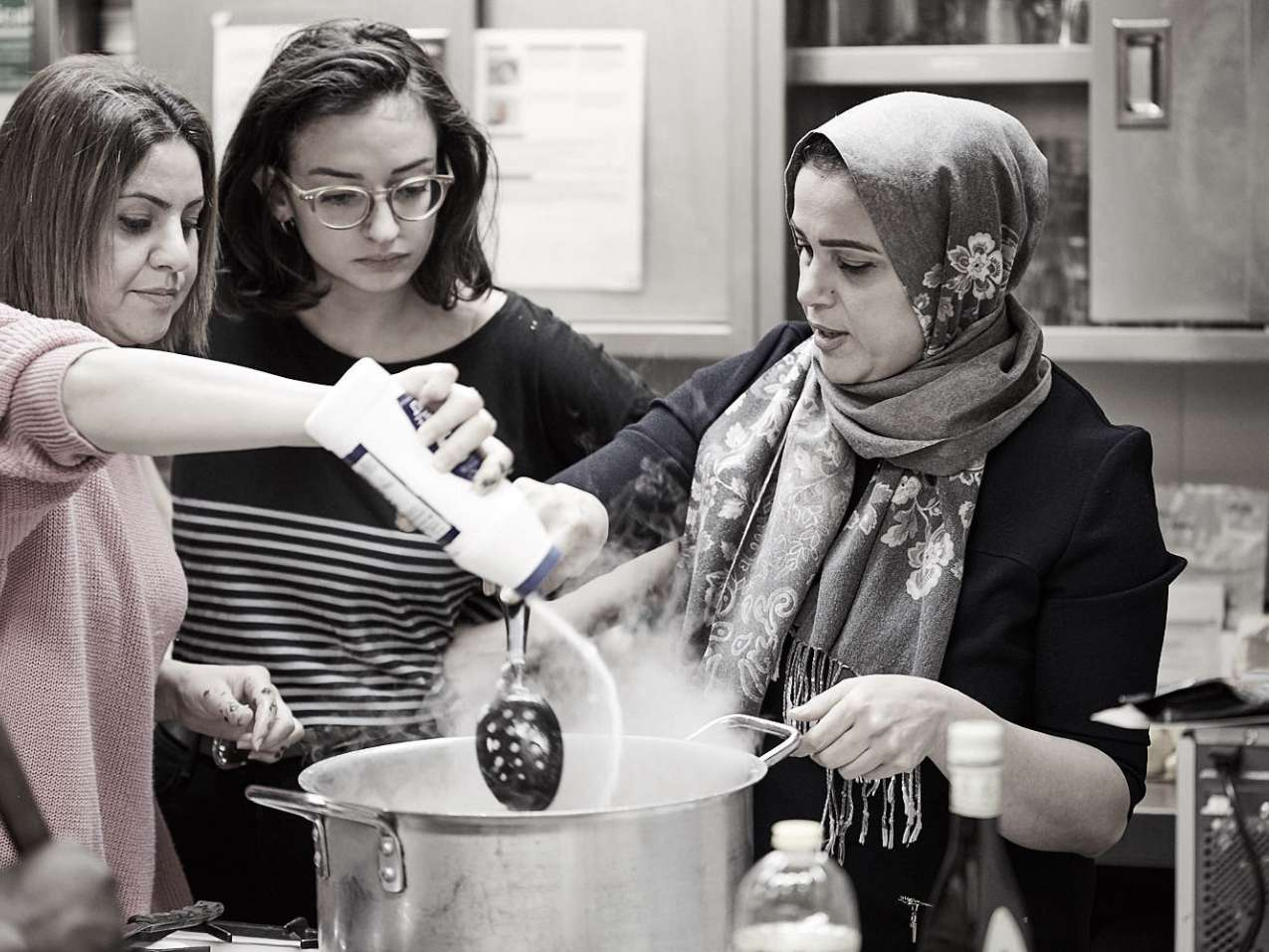 Refugees and Asylum Seekers teaching clients dishes from their home countries.