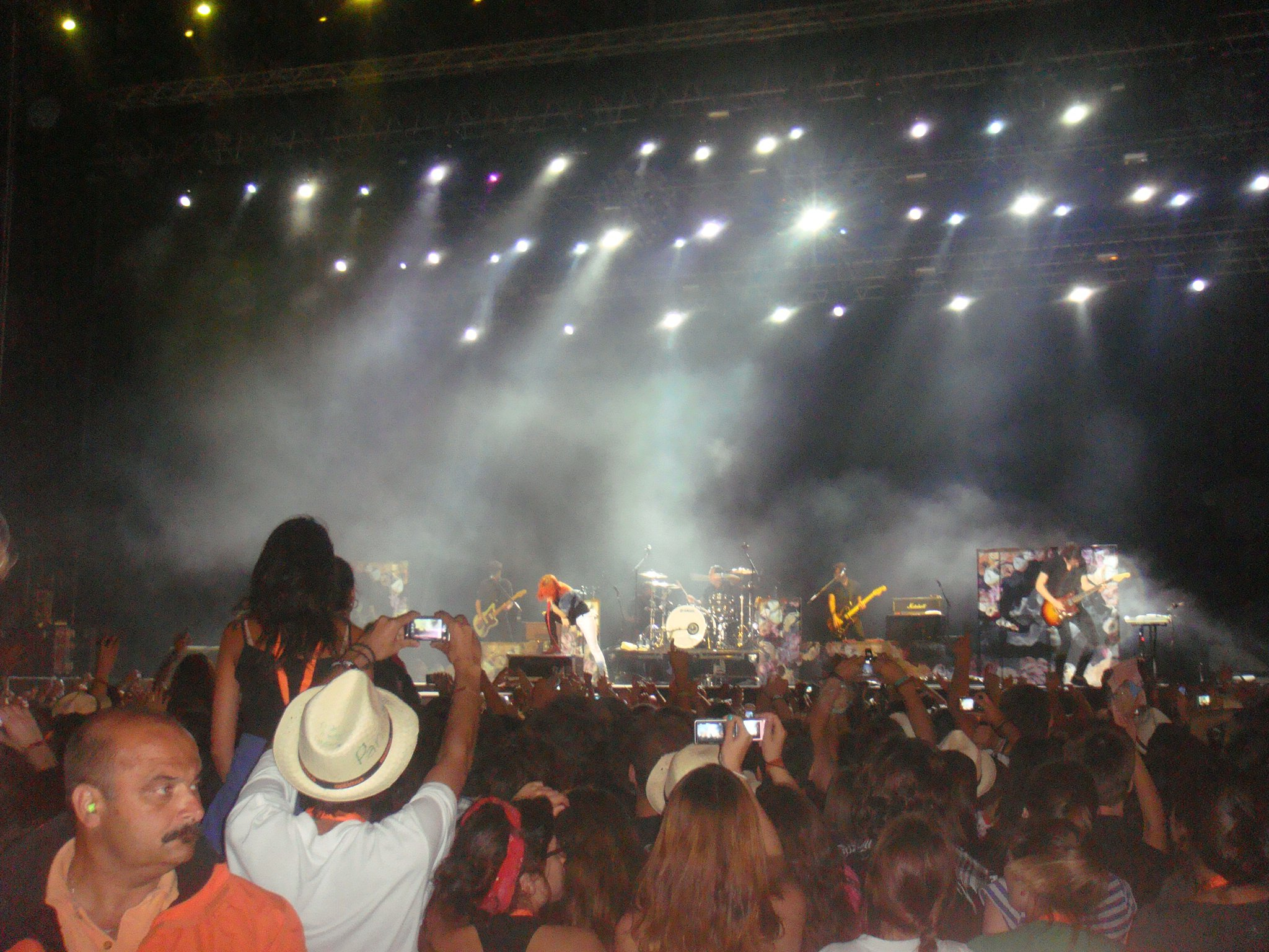 Paramore gig, the band playing in the background, the crowd is cheering