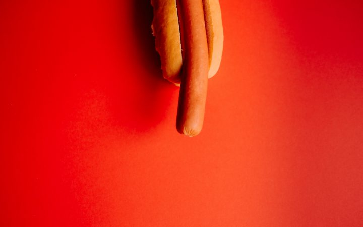 Hotdog on red backgroud [Annie Spratt]