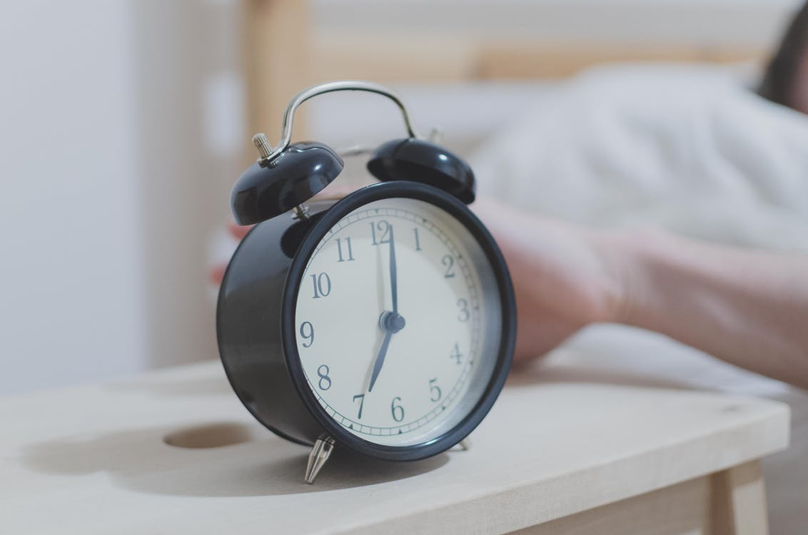 Alarm clock on side table