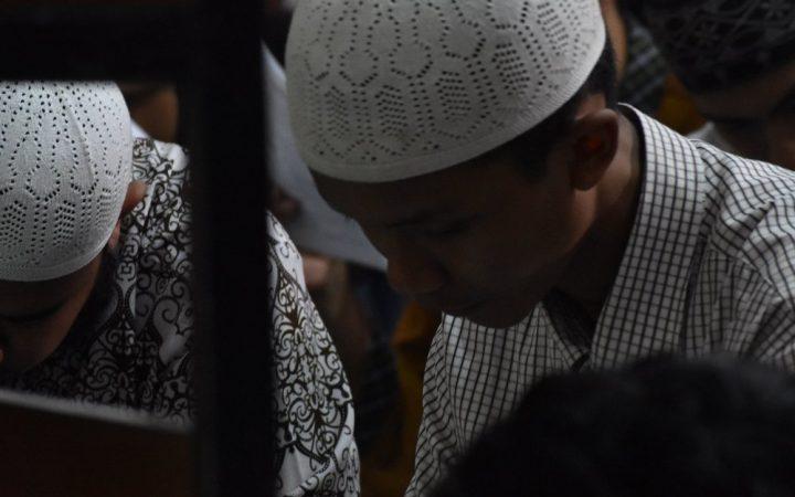 Child praying in group