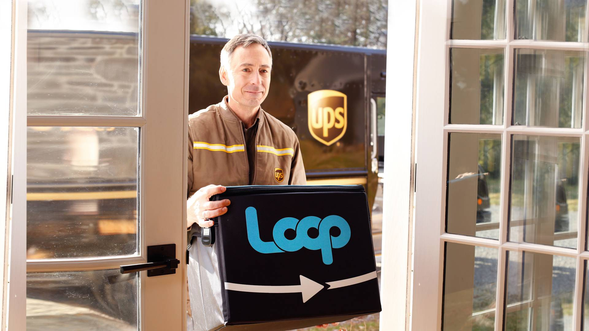 Delivery man delivering loop package