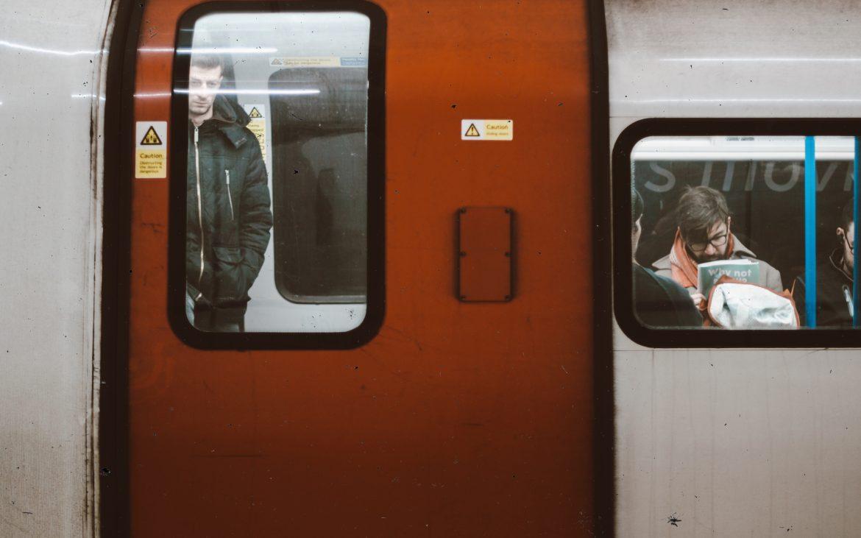 Man standing on the tube [Irene Chirita]