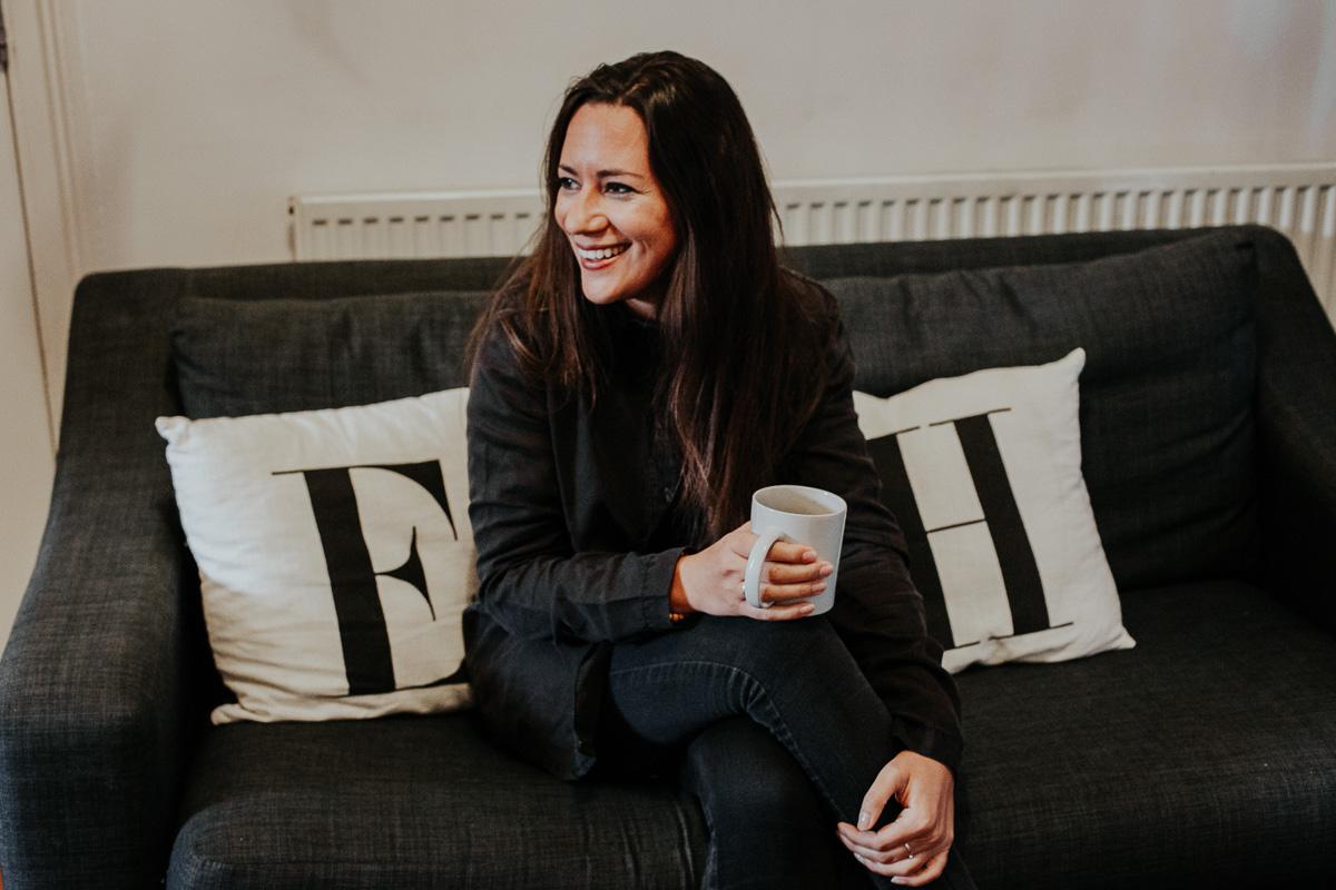 Emily Chalke, founder of Ella's Home, sat on sofa