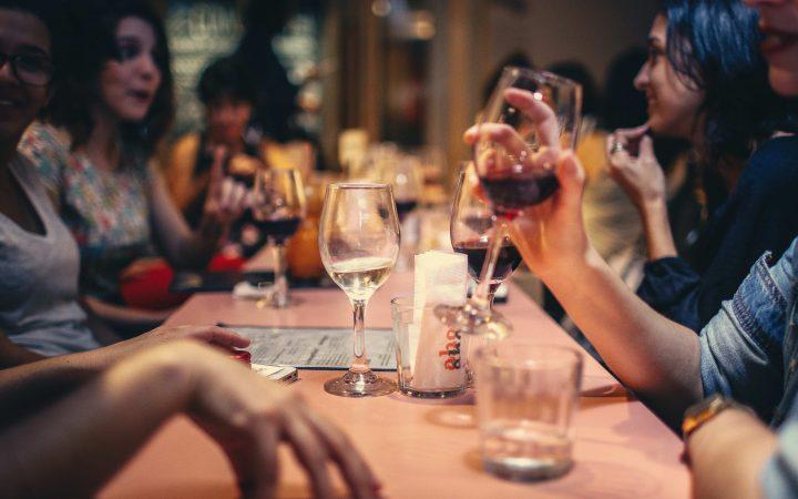 Girls drinking wine in pub