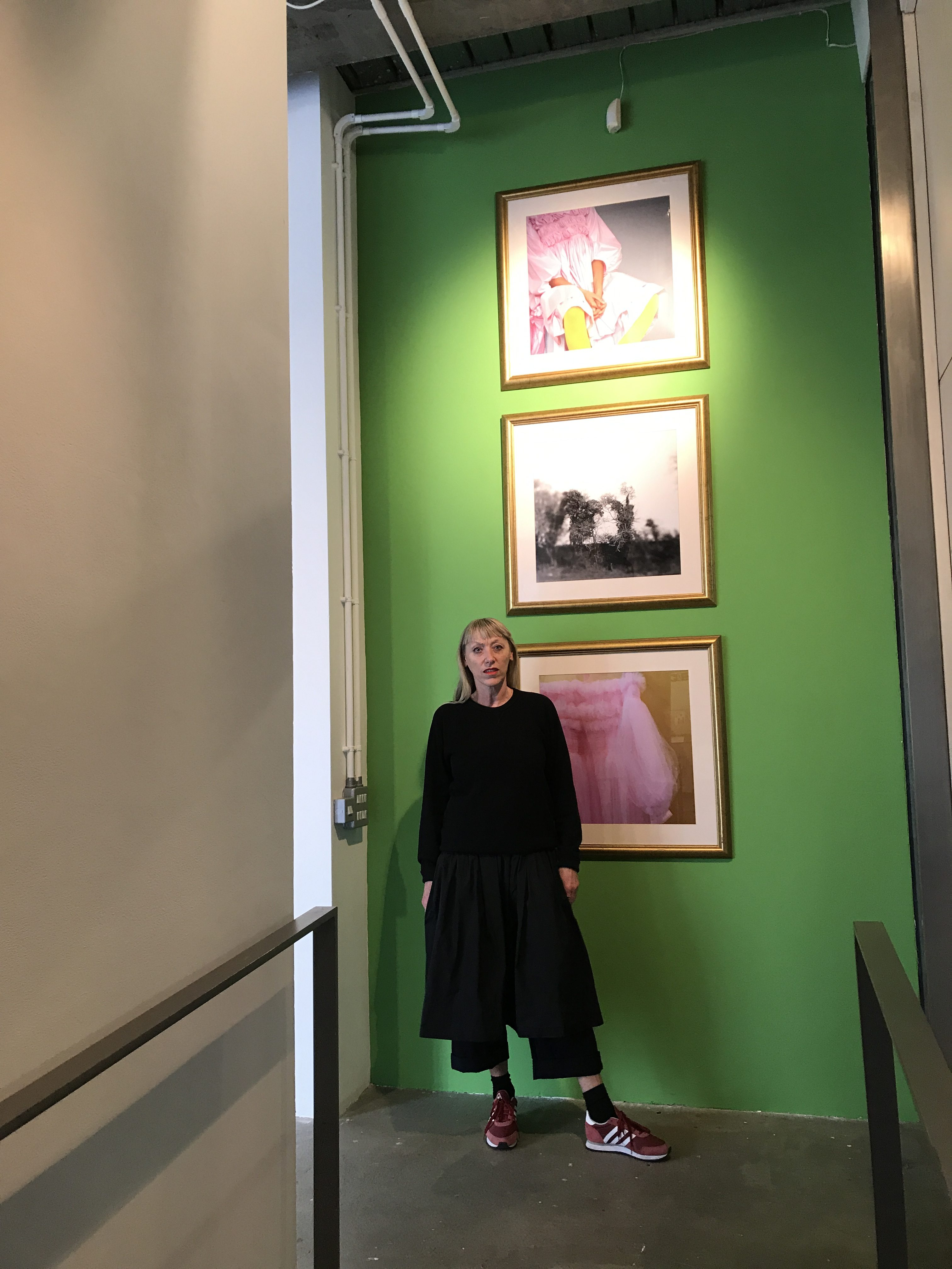 sarah edwards in front of green wall