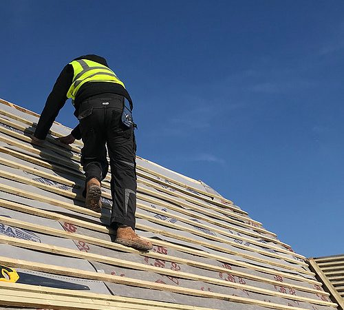 Builder working on the roof
