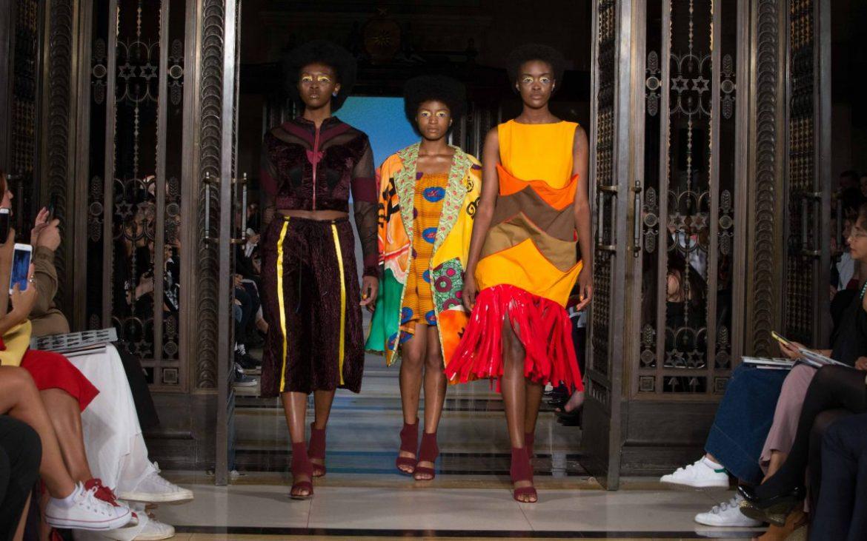 FAD at London Fashion Week. Three models walking down the runway in FAD Fashion Future designs.