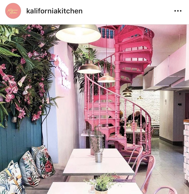 Spiral staircase and botanical interior inside Kalifornia Kitchen
