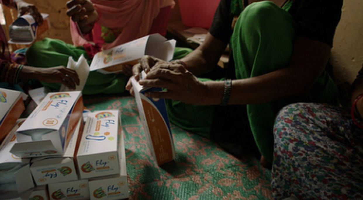 Women are preparing their Fly pad products in it's packaging to be distributed to the women in their village.