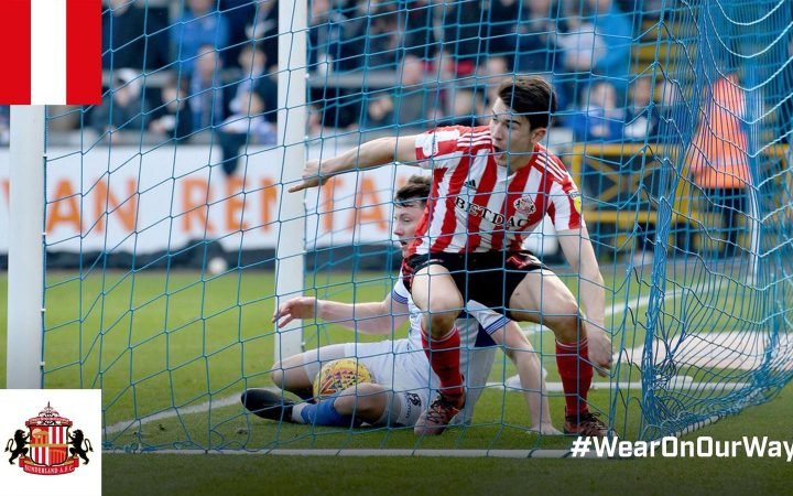 Luke O'Nien professional footballer for Sunderland FC scores a goal against Bristol Rovers and celebrates in the goal