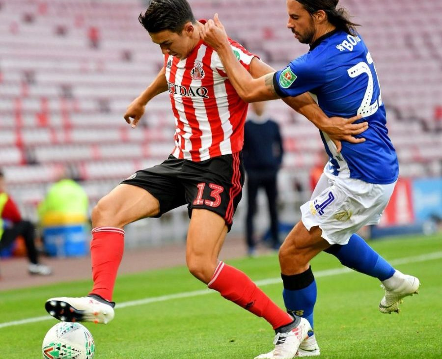 Luke O'Nien professional footballer for Sunderland FC is fending off Boyd from Sheffield Wednesday.