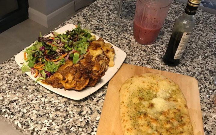 Luke O'Nien's dinner. Garlic bread with half a plate of home made mixed leaf salad the other half lasagne. A berry smoothie for after.