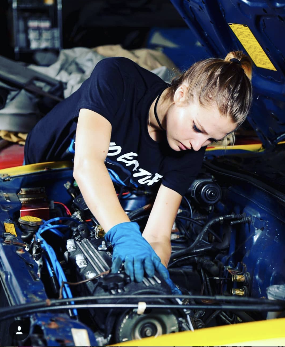 Modified Girls member working on her car