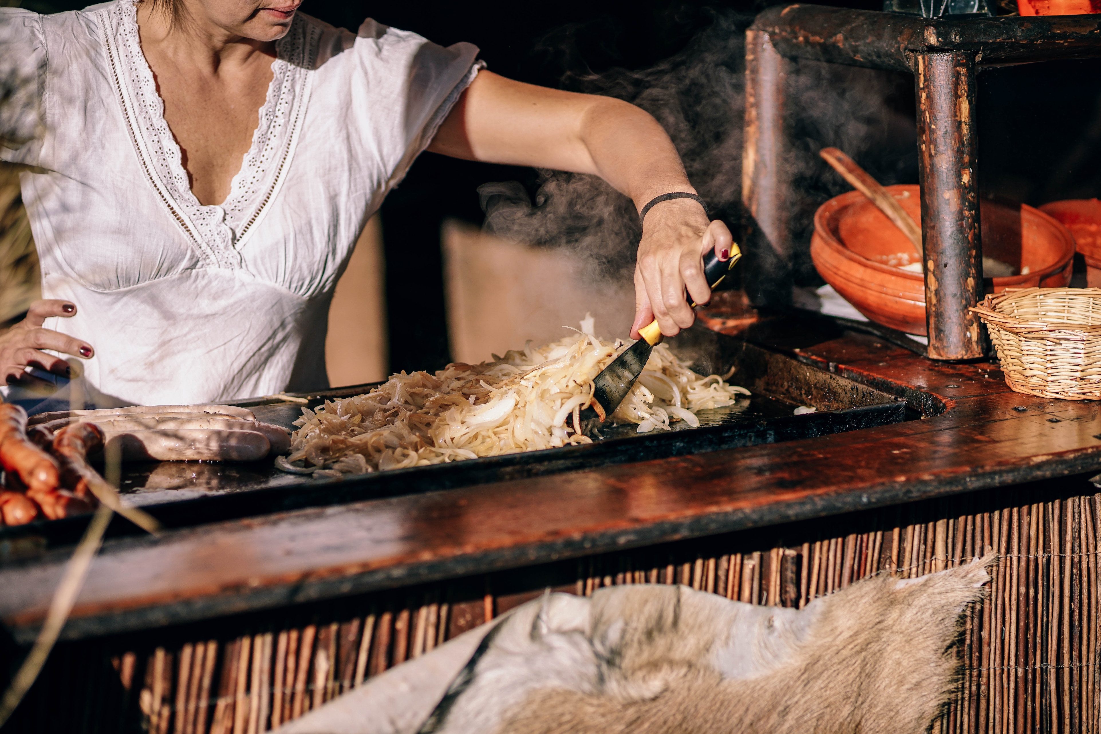 A woman cooking outside