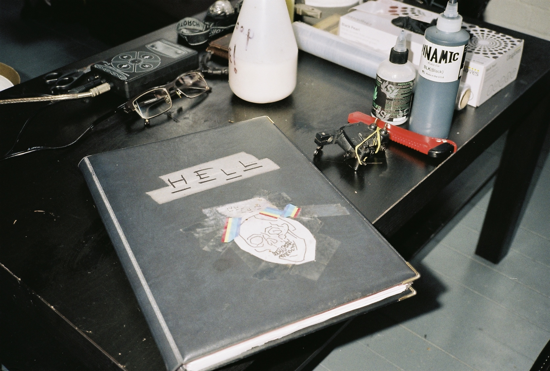 Ross' tattoo flash book laid out on his table.