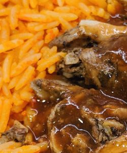 A close up of Food Junkee's jerk chicken and jollof rice