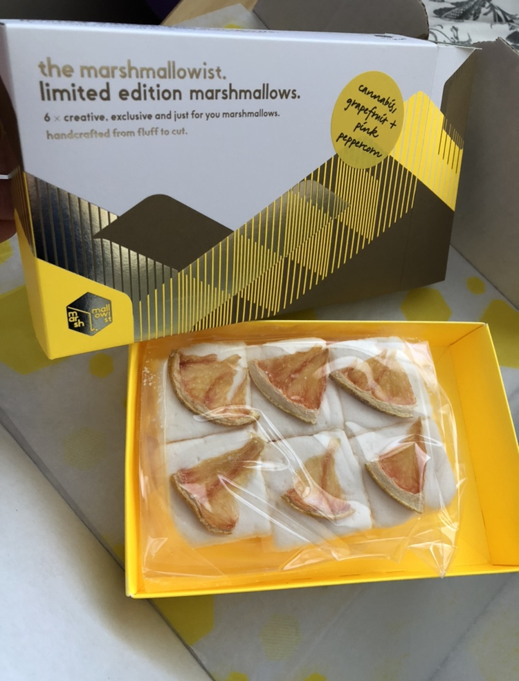 Cannabis marshmallows topped with dried grapefruit inside a yellow box