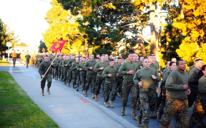 Marines partaking in a formation run and Field Meet competition