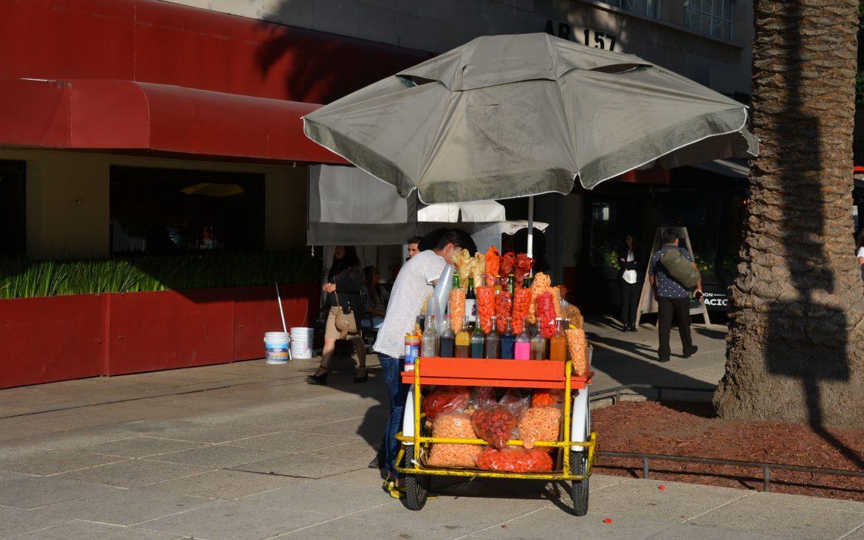 Street vendor selling 'papas' and 'dorilocos.