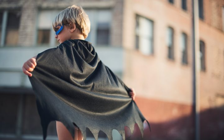 A little boy dressed as Batman