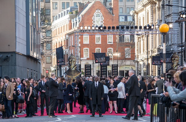 Crowd of people on the red carpet at the olivier awards