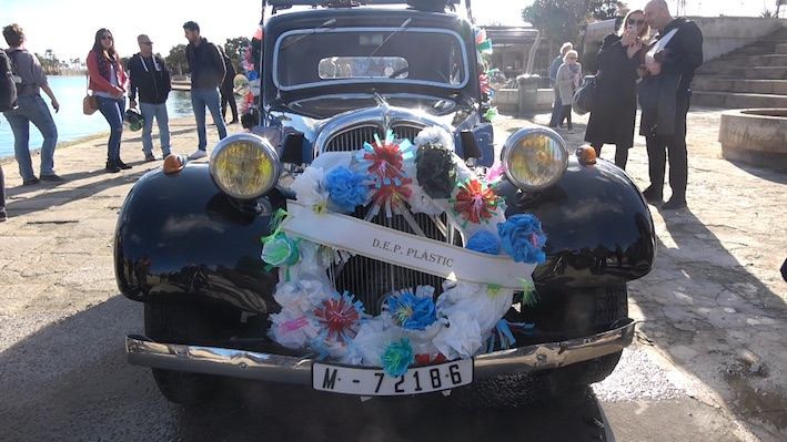a vintage car with flowers attached to the front