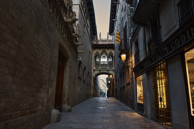 A dark street in the gothic quarter of barcelona