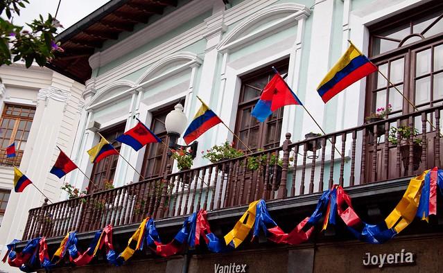 ecuador flags along a building
