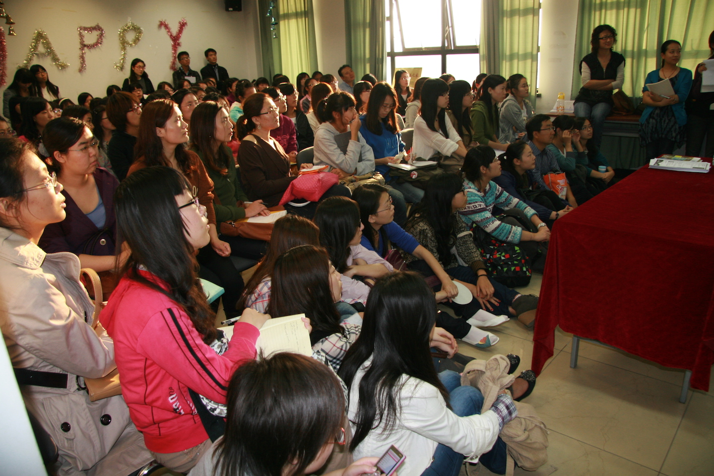 chinese students listening to teacher in lesson