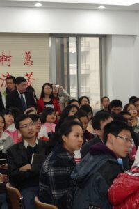 zoomed in chinese students in lesson