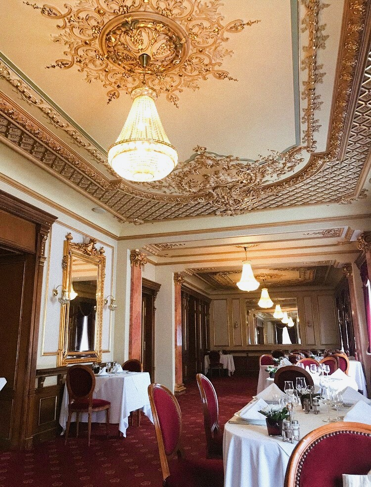 casa capsa inside with ornate ceiling and chandelier