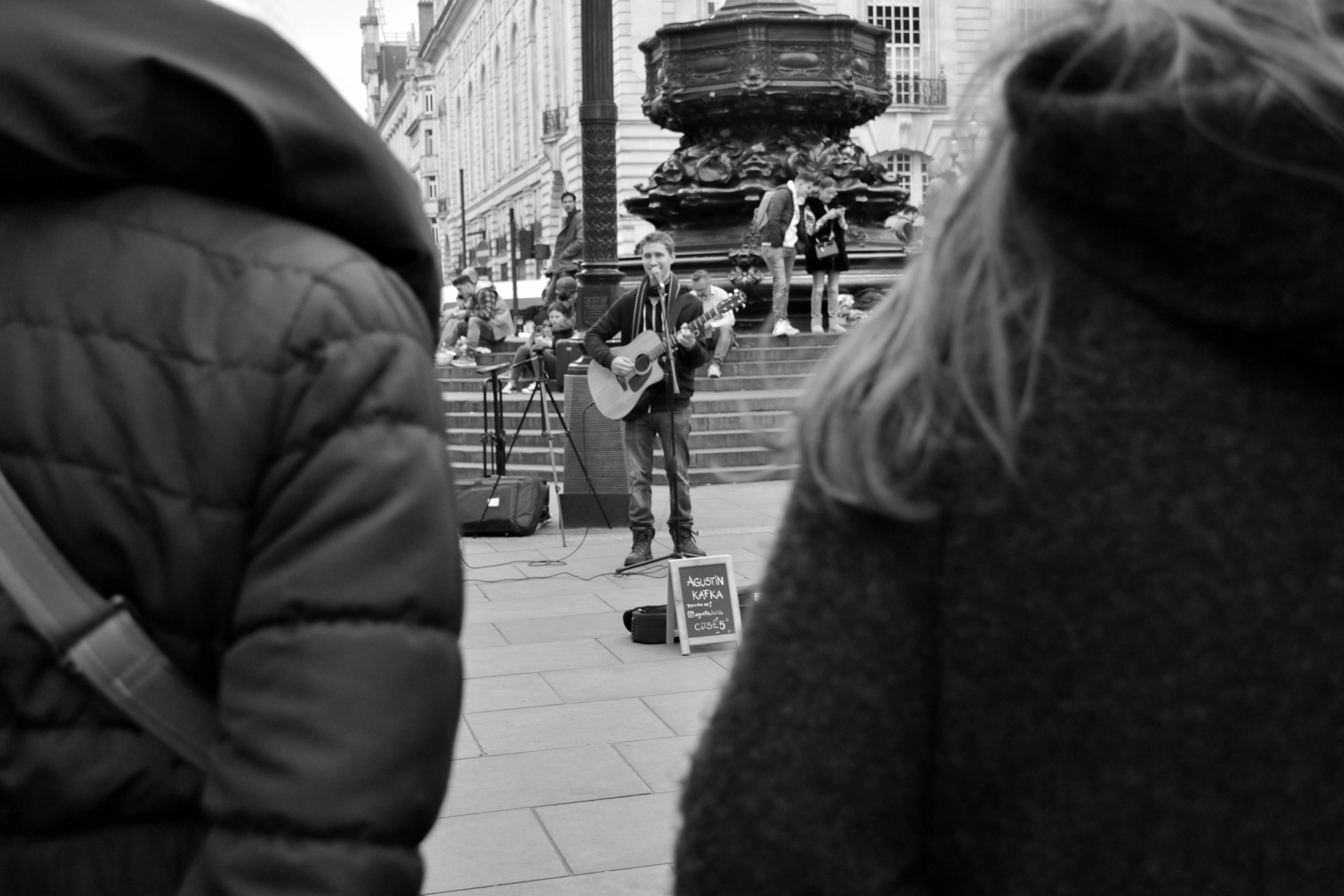 view of people watching the busker