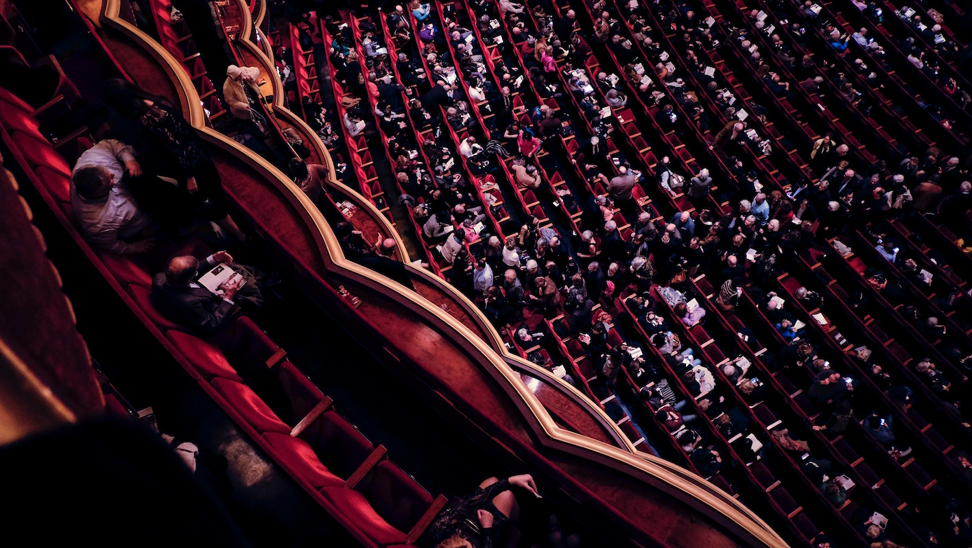 birds eye view of a theatre, red chairs