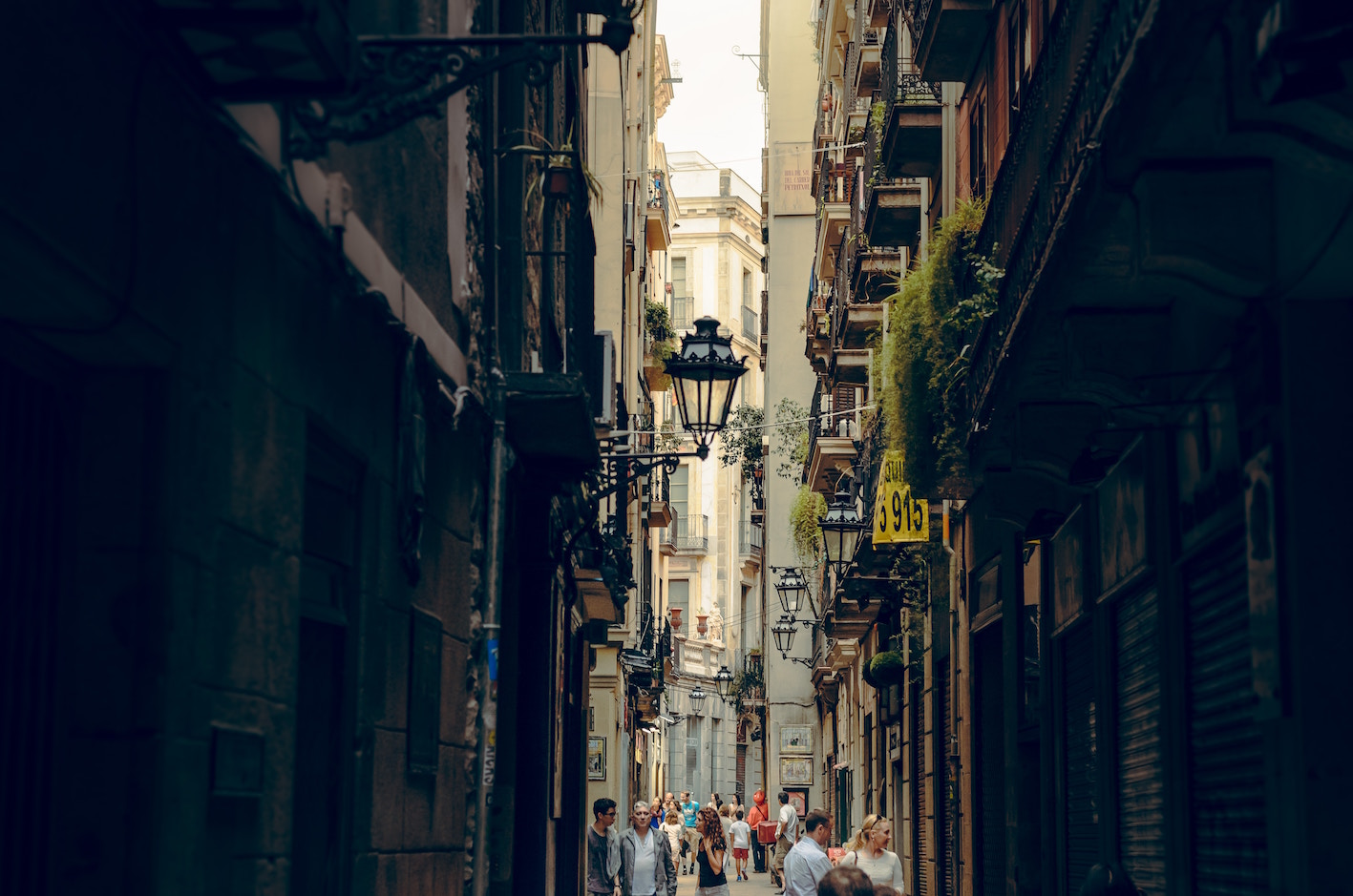 A narrow street in Barcelona with people in the distance