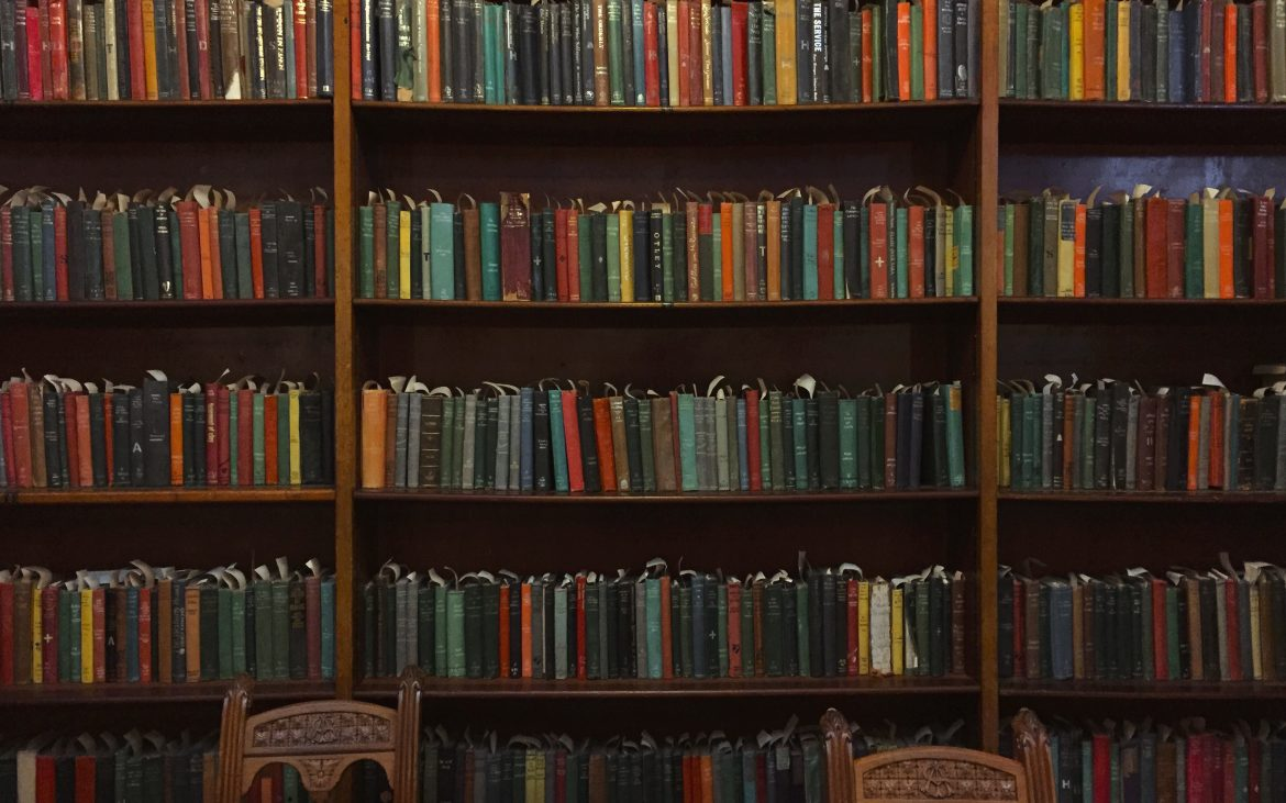 Rows of filled bookshelves, with colourful and characterful books.