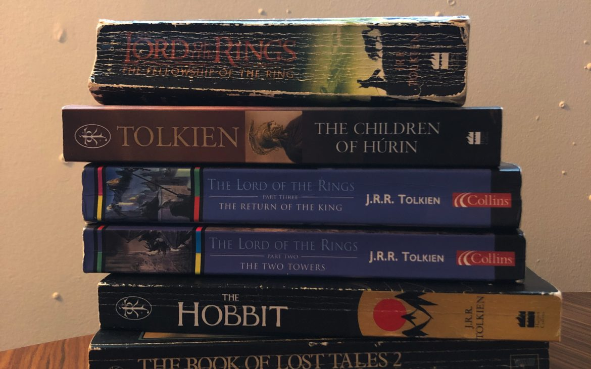 Books written by J.R.R. Tolkien stacked, including The Lord of The Rings and The Hobbit.