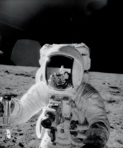 An image of astronaut Alan Bean standing on the surface of the moon.