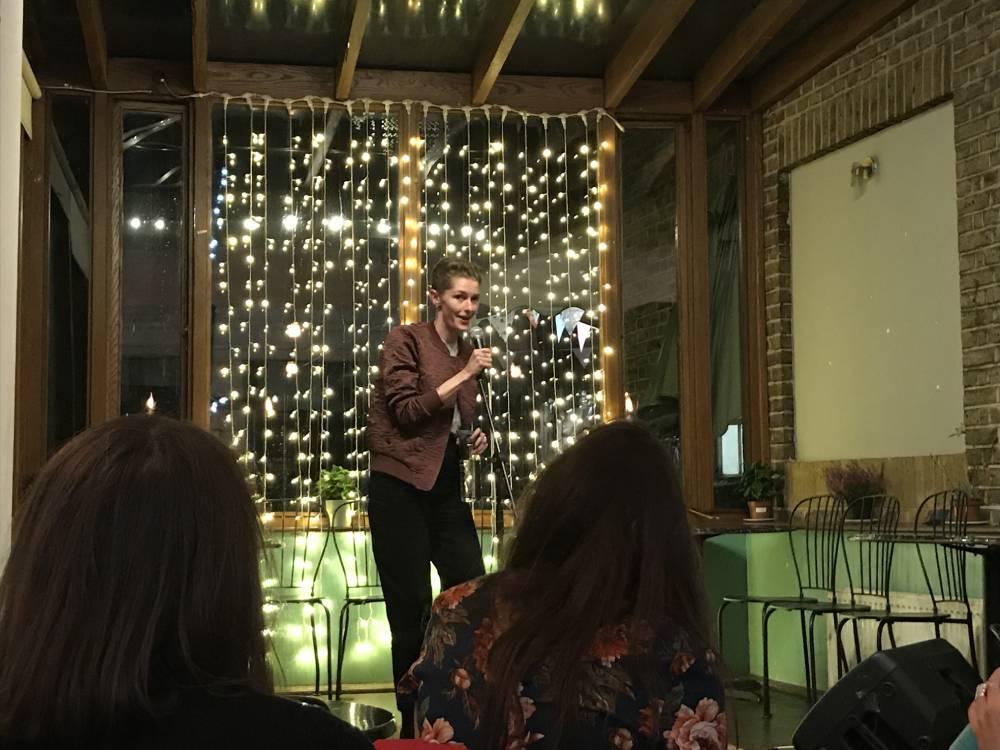 MC, Chloe Green on stage at Big Mouth comedy event