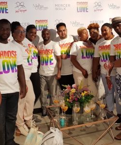 Aloysius and members of the club wear t-shirts from the Choose Love campaign