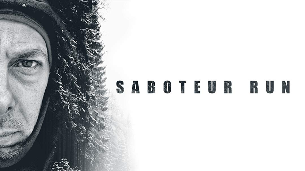 A poster for a Saboteur Run featuring a close up of half of Rob's face and his cold-weather clothing