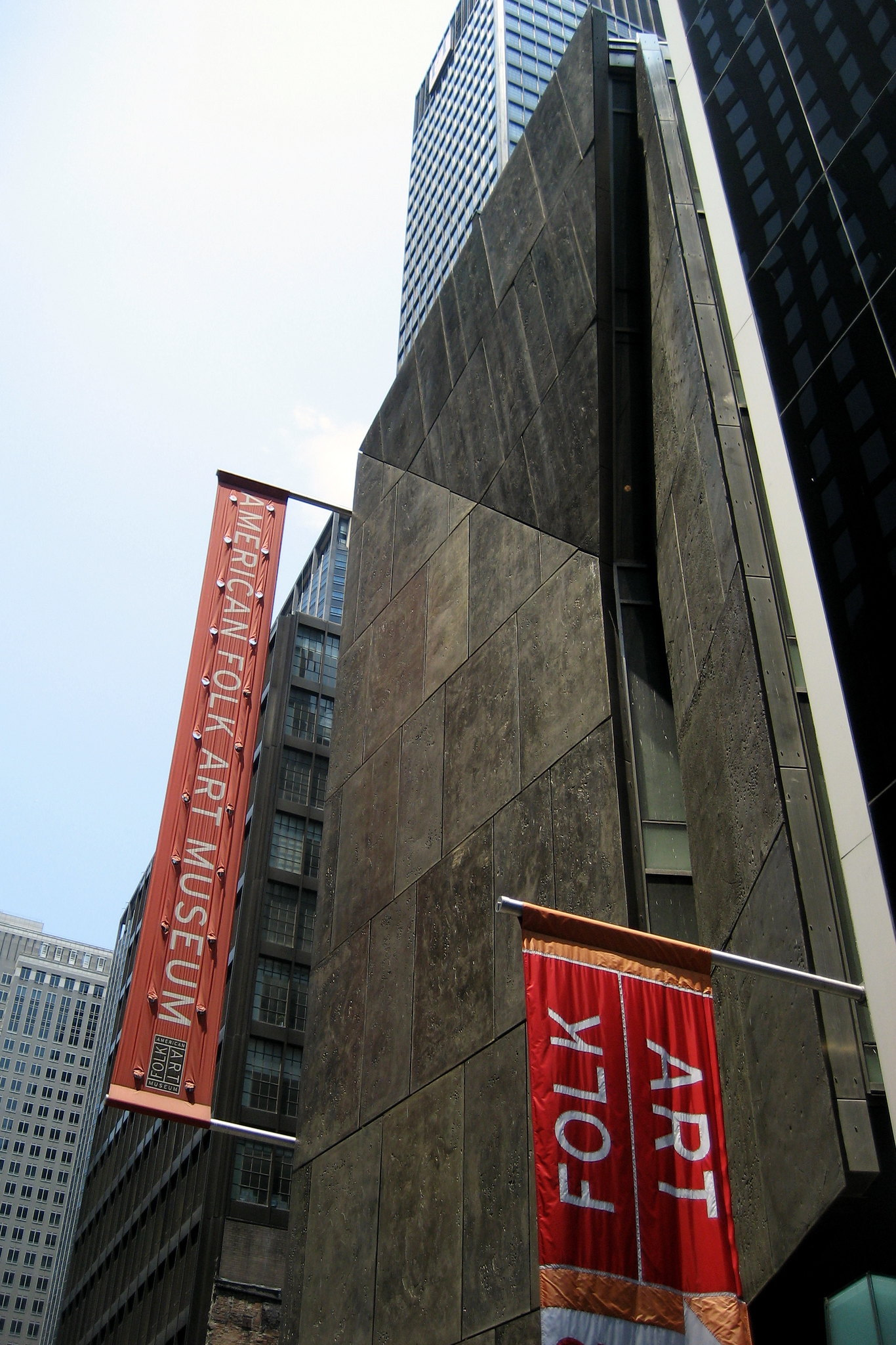 An exterior photograph of the American Folk Art Museum in New York, which houses Darger's work/
