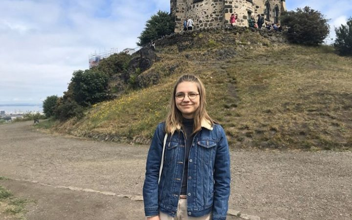 Emilia on holidays in Edinburgh, smiling to the camera