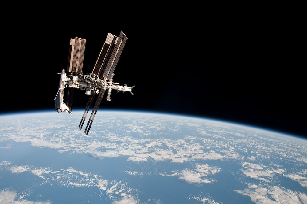 An image of the international space station floating above Earth