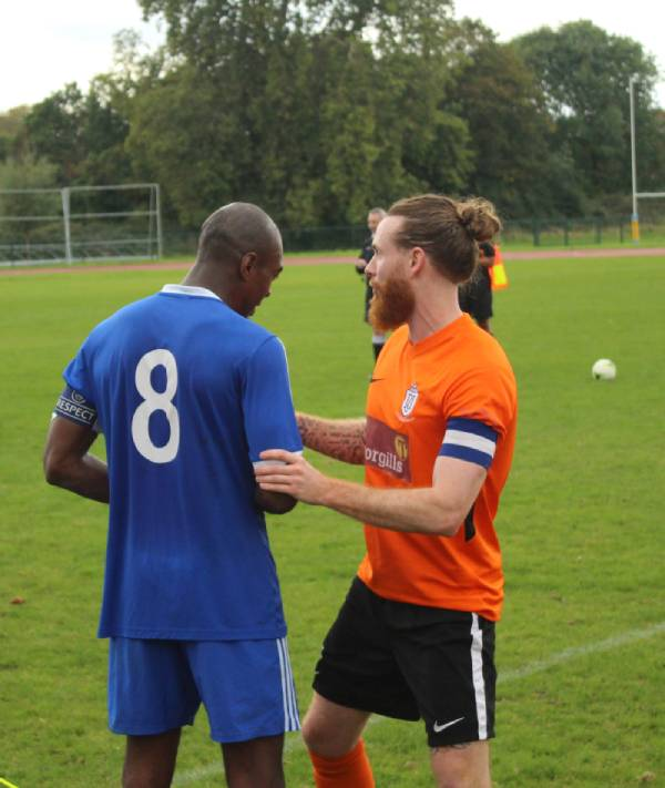 Stonewall FC captian Jay Lominous chats to opposition captian at half time.